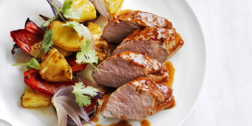 landscape-1426188625-sweet-smoky-pork-tenderloin-pineapple-peppers-recipe-wdy0415